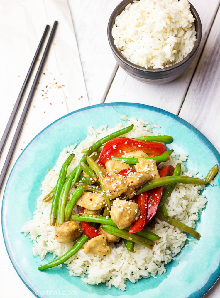 This 30 minute coconut sesame chicken and green beans skillet is a tasty and fresh dish that combines coconut oil, fresh honey, chili flakes, and garlic and then drizzled over fresh chicken and green beans and baked to tender perfection!
