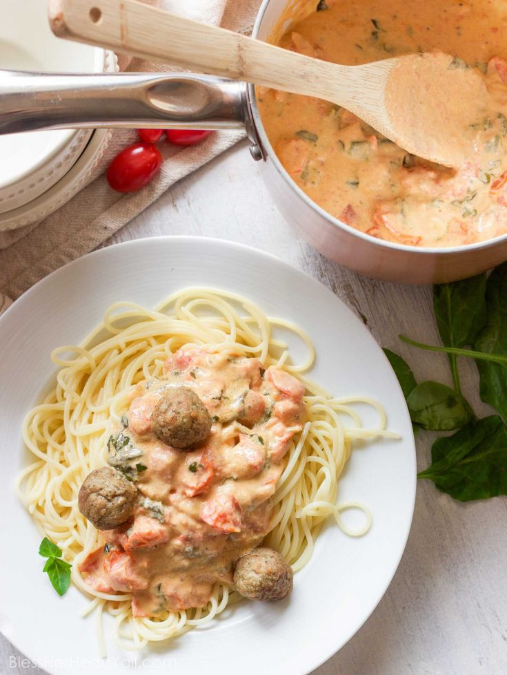 This easy goat cheese spaghetti and meatballs recipe combines fresh goat cheese, smashed tomatoes, and fresh basil, garlic, and onion for a delicious meal in less than 20 minutes!