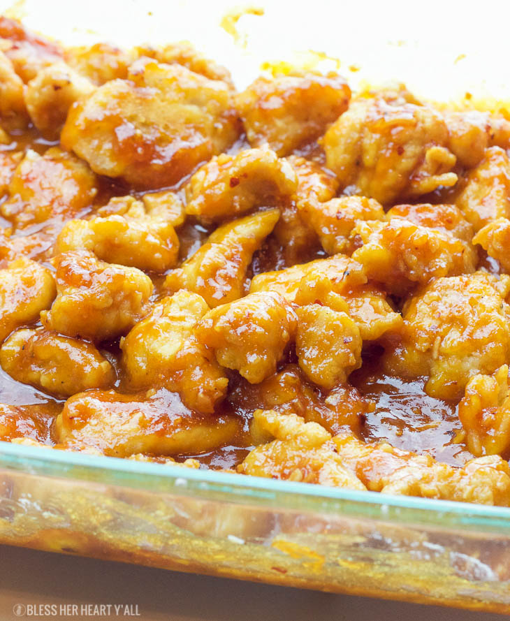 This one-pan baked gluten-free sweet and sour chicken recipe is 100% gluten-free and not fried in a frying pan for even a second. Tender pieces of chicken are lightly breaded in a homemade spiced coating and then drizzled in coconut oil and a sweet and tangy sticky sauce and then baked to perfection.