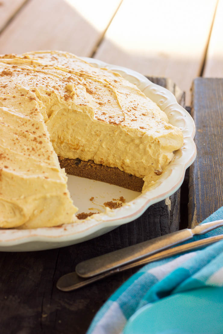 This gluten-free no-bake peanut butter cookie pumpkin cheesecake is made out of a peanut butter cookie crust and filled with a dreamy and creamy pumpkin cheesecake that will satisfy anyone's sweet tooth this holiday season!