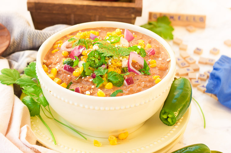 This slow cooker white turkey chili combines juicy leftover roasted turkey, chunky vegetables, and garlic, oregano, paprika, and spice to make a delicious stick-to-your-ribs meal that's so simple to make and so comforting to eat! It's also gluten free, dairy free and low carb! www.blessherheartyall.com