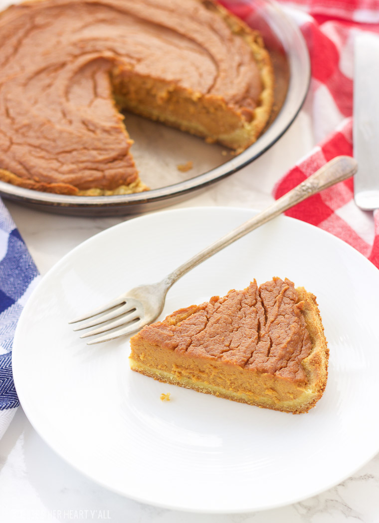 This paleo sweet potato pie is made with simple healthy ingredients and is both decadent and smooth. This southern treat is also gluten free, grain free, and dairy free! Bring on the holidays with this easy recipe y'all! www.blessherheartyall.com