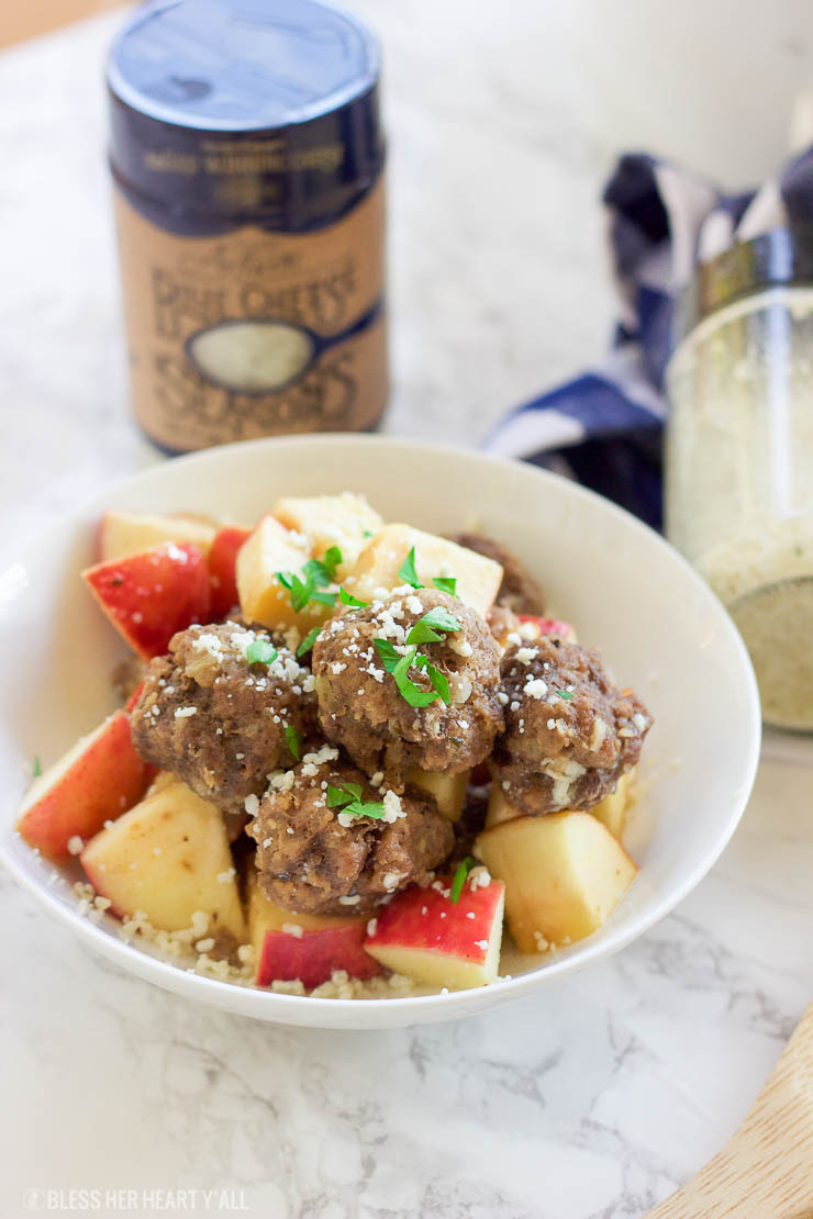 This easy slow cooker apple cider meatball recipe dunks fresh meatballs and juicy apple slices in apple cider, garlic, and blue cheese crumbles for a delicious fall spin. Bring them to a fall party and they will be gone in seconds! www.BlessHerHeartYall.com