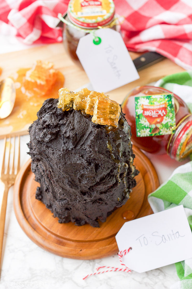 This gluten free dark chocolate honey triple layer cake is the ultimate in chocolate decadence. Three moist chocolate mini cakes are stacked with rich dark chocolate frosting layers before being topped with lush honeycomb pieces and gooey honey drizzle. Perfect holiday gift idea for the chocolate and honey lover in your life!