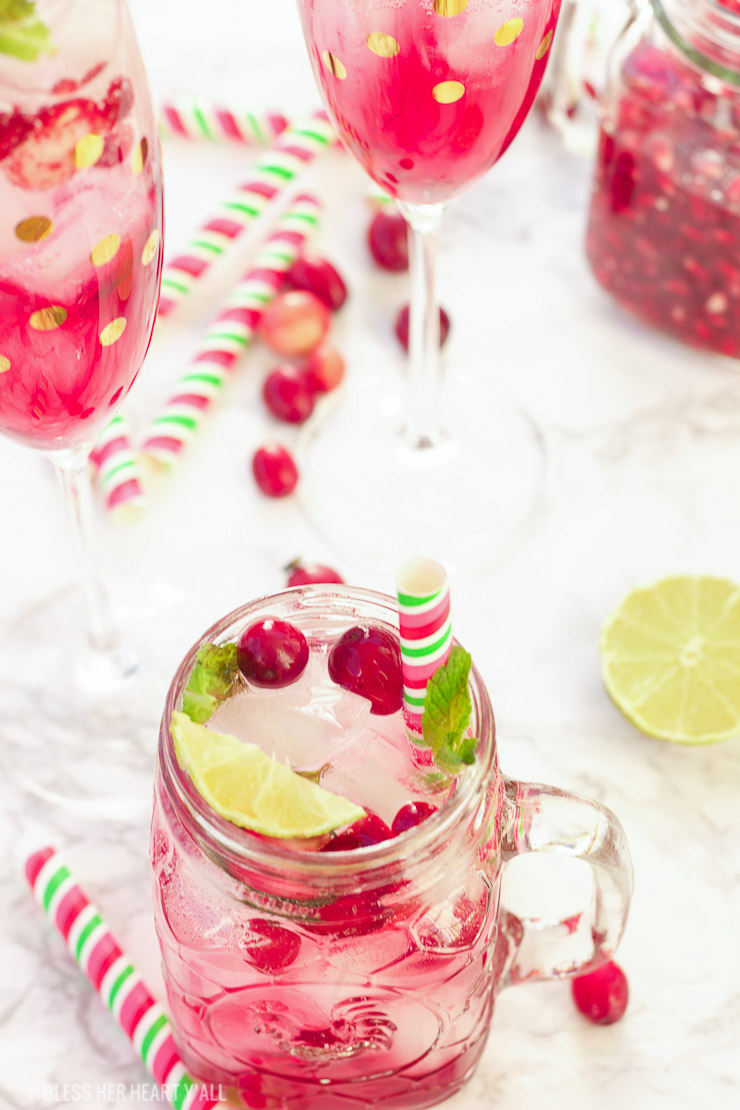 This pomegranate cranberry mojito recipe tastes just as it looks - juicy, sweet, refreshing, and light! With only a few simple ingredients, these cocktails are perfect for your winter holiday parties and for ringing in the new year!
