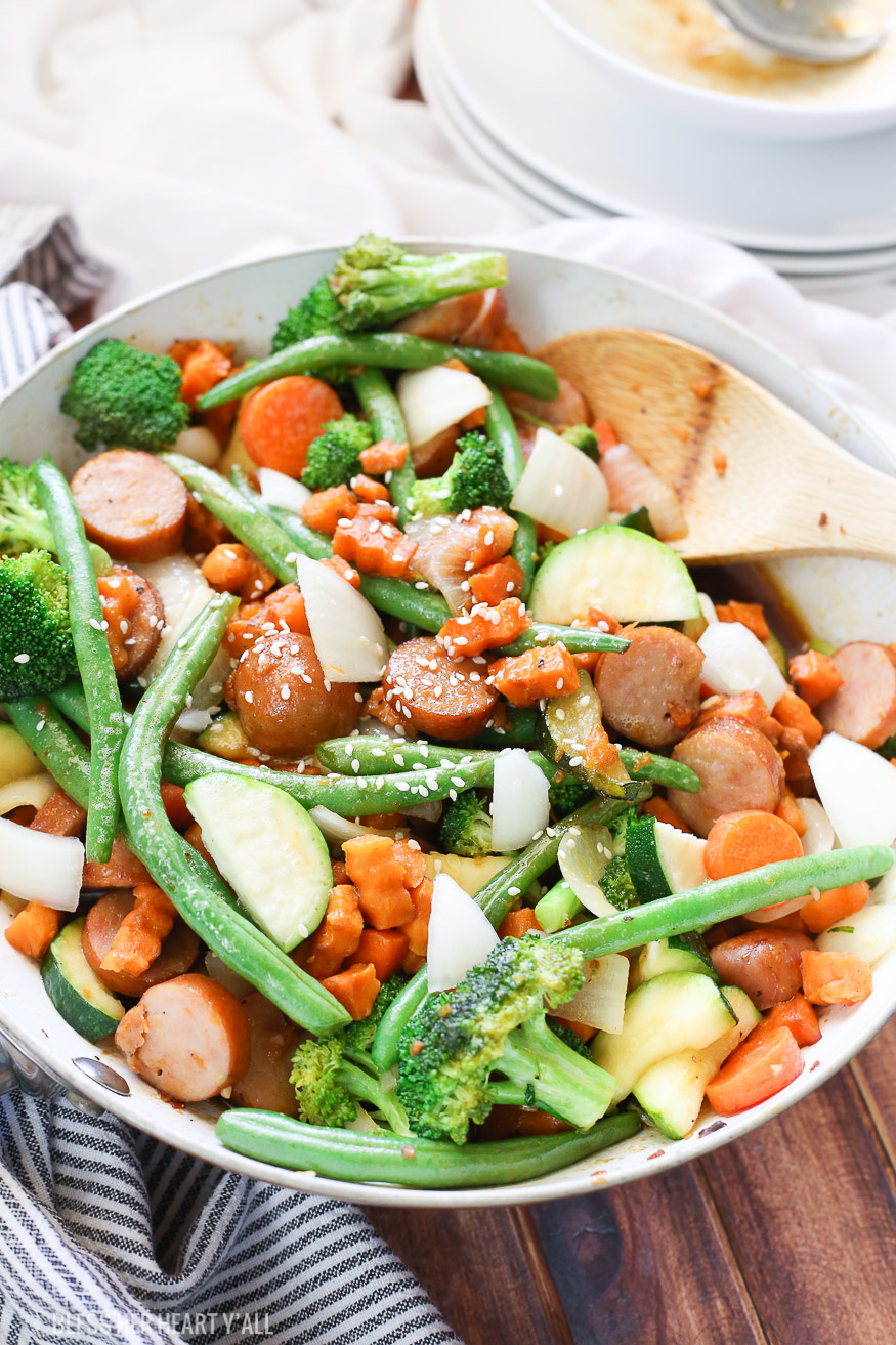 Sweet potato stir fry with chicken sausage slices are combined with fresh vegetables and a simple sweet and savory paleo stir fry sauce for one epically healthy meal your family will ask for time and time again.