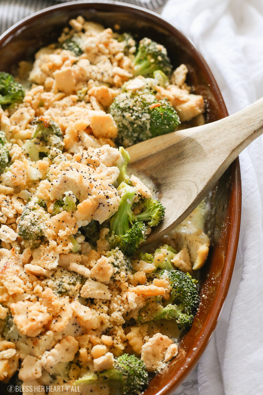 A skinny gluten free chicken poppy seed casserole that combines juicy chicken and fresh broccoli pieces in a homemade healthy poppyseed cream sauce, topped with butter toasted cracker crumbles, and baked to golden perfection in 15 minutes!