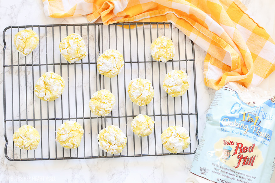 Gluten free lemon crinkle cookies combine light fresh lemon flavors into soft and doughy cookies that are sprinkled in delicious powdered sugar before being baked for a quick 10 minutes!