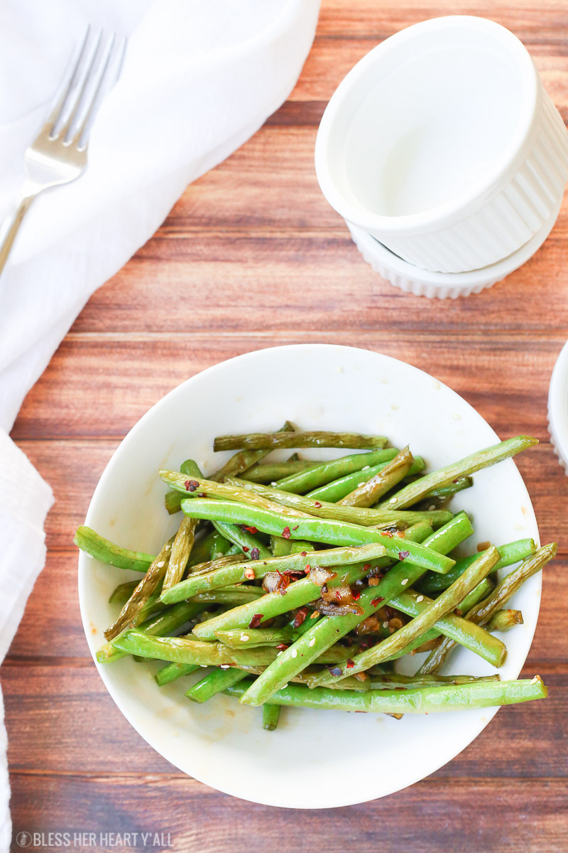 This easy 10-minute teriyaki green beans recipe sautées fresh or frozen green beans with chopped onion and garlic in a quick homemade teriyaki sauce that will leave you licking your plate clean!
