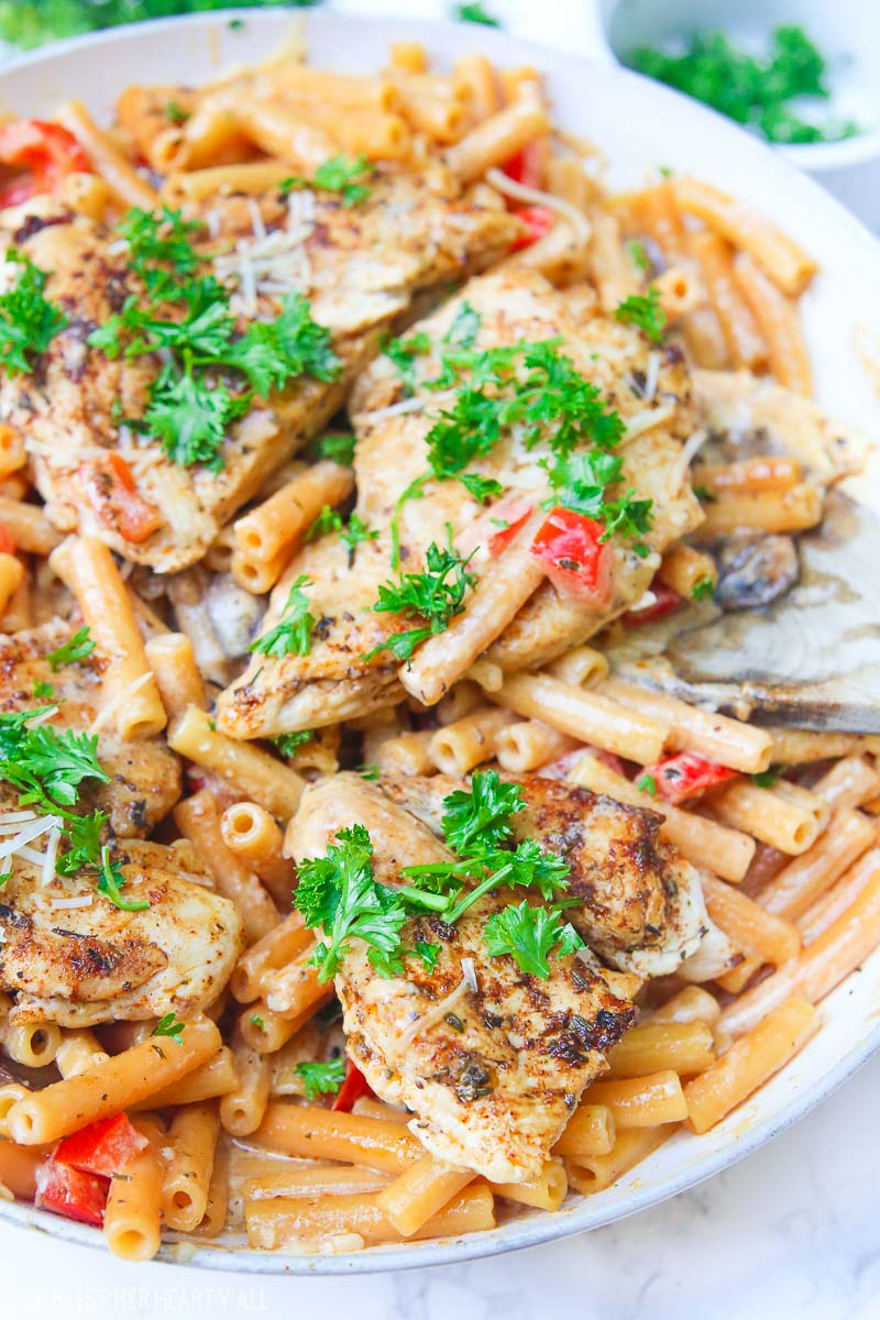 Cajun chicken pasta melts juicy cajun-seasoned chicken breasts with al dente gluten-free noodles in an easy creamy pasta sauce and sprinkled with extra gooey cheeses and herbs all in under 30 minutes! image 2