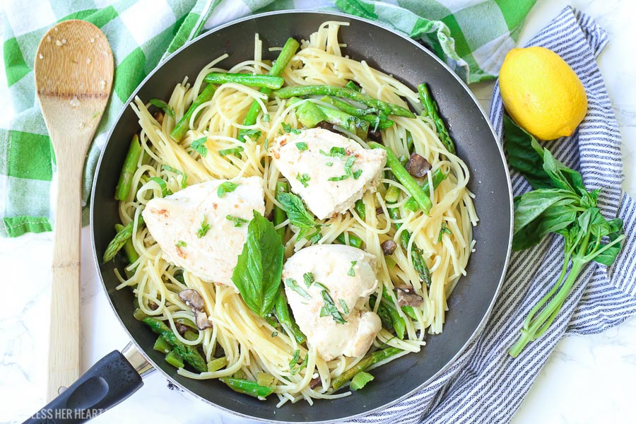 This chicken pasta in garlic basil butter sauce recipe makes for an easy gluten free dinner for busy weeknights. Pasta and chicken is tossed with the vegetables you already have in your kitchen and drizzled in a sizzling light and creamy garlic butter sauce with extra hints of basil and lemon! image 3