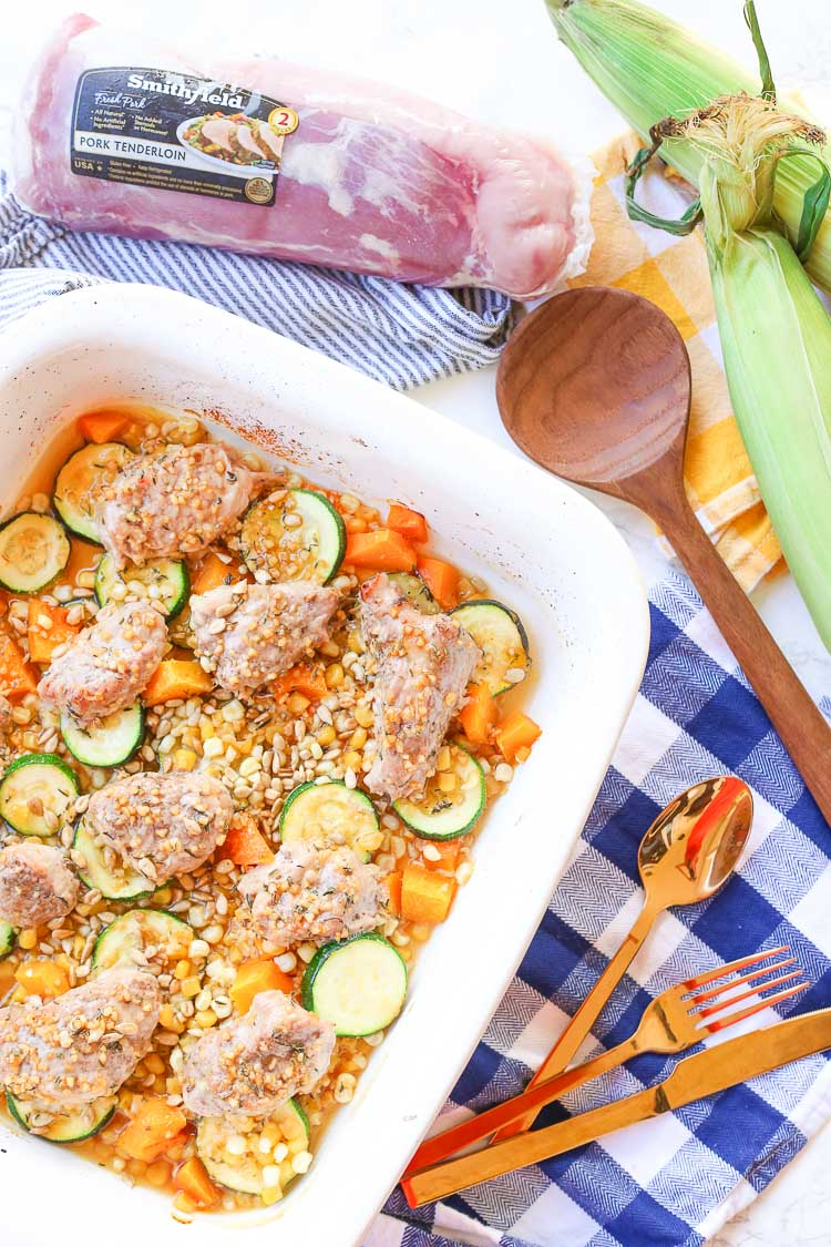 Roasted honey garlic autumn pork and vegetables is a quick and easy weeknight dinner meal prepared in about 30 minutes with real flavor real fast!  Honey garlic sauce is drizzled over seasonal vegetables and juicy pork medallions!