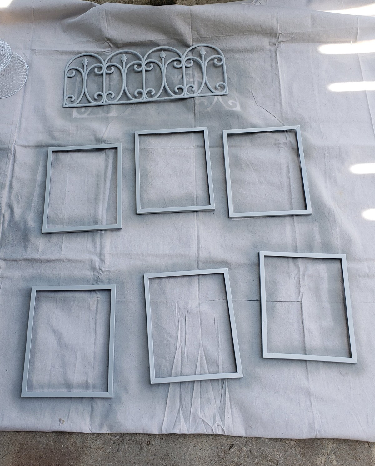 Paint the frames and garden edging on all sides
