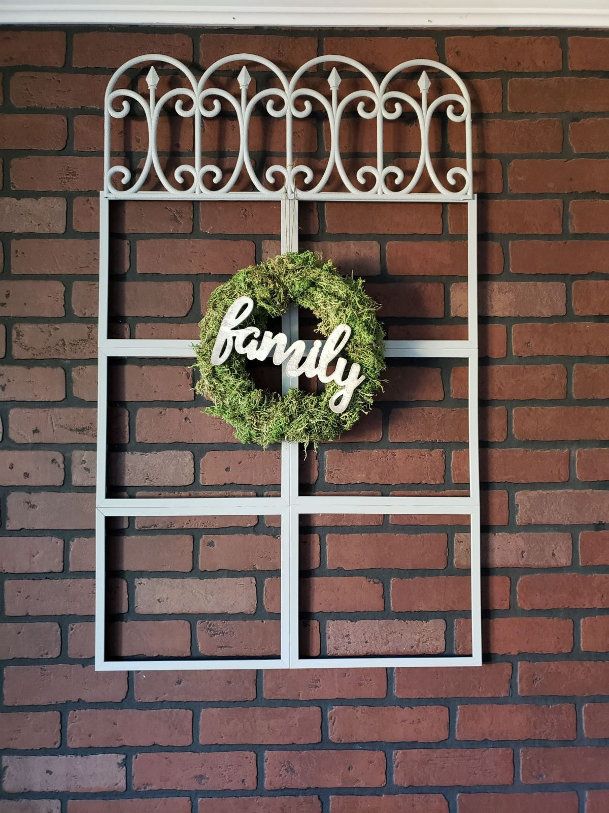 Completed farmhouse window with wreath attached