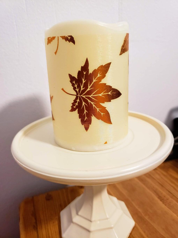 Glue ribbon around candle