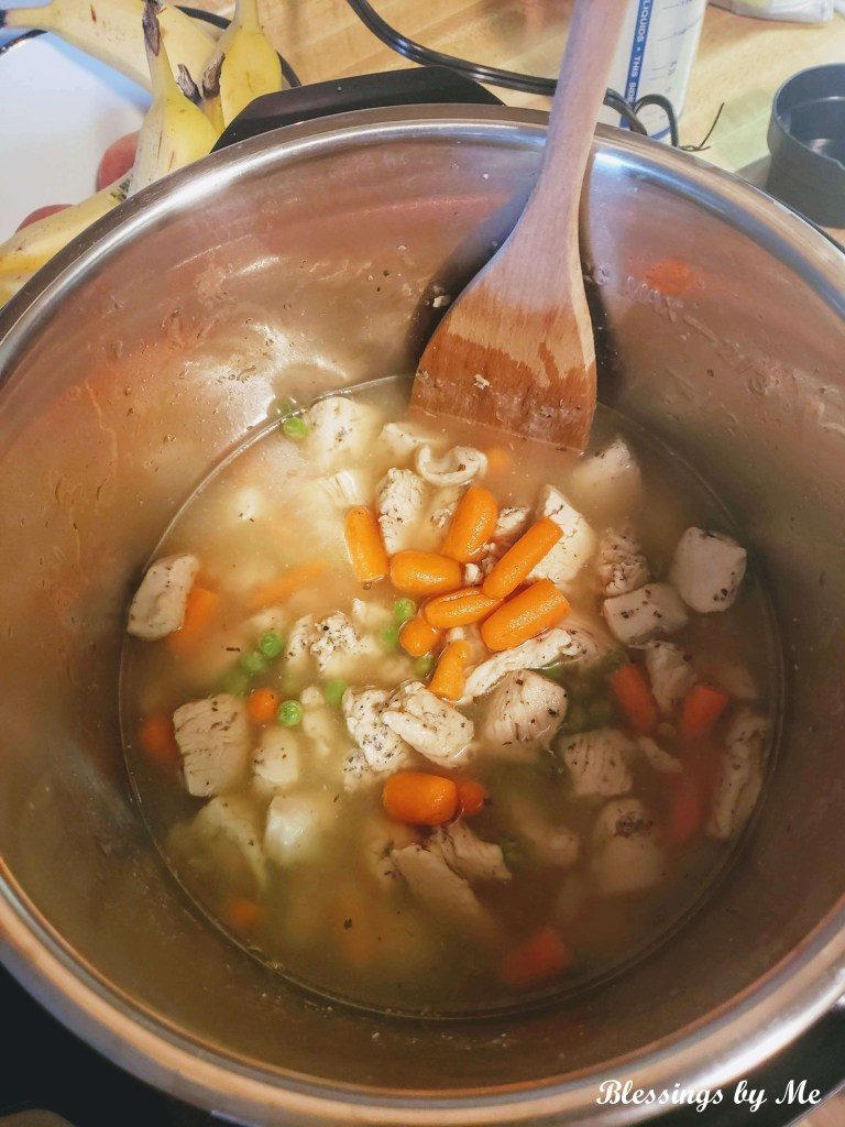 Stir in ingredients - instant pot chicken & dumplings