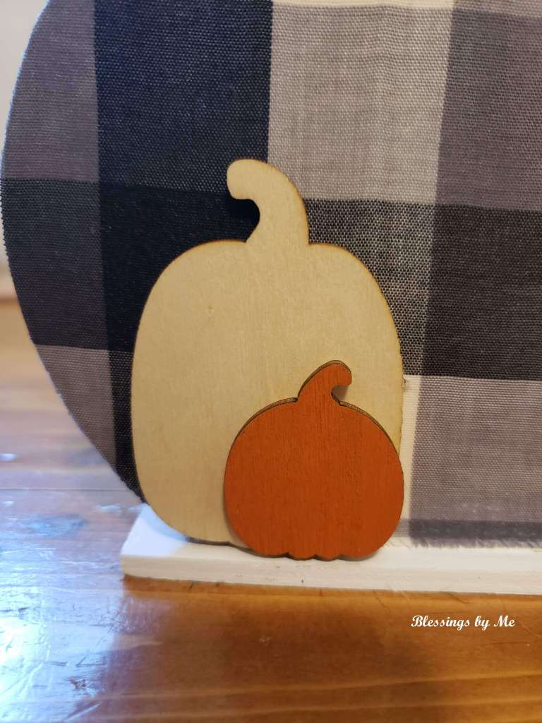 Add a smaller wood pumpkin sticker to the bigger wood pumpkin
