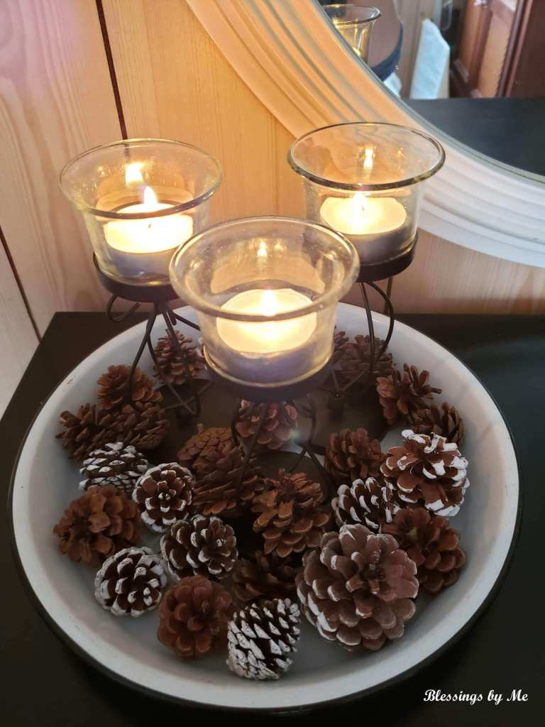 Winter candles and pine cones