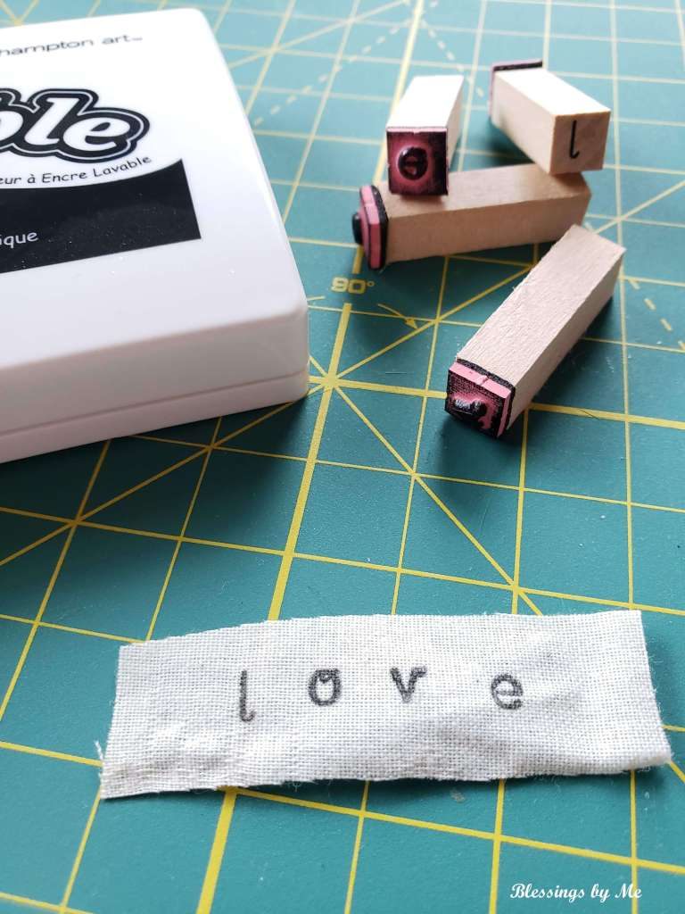 Step 4 - stamp the letters on the fabric hearts