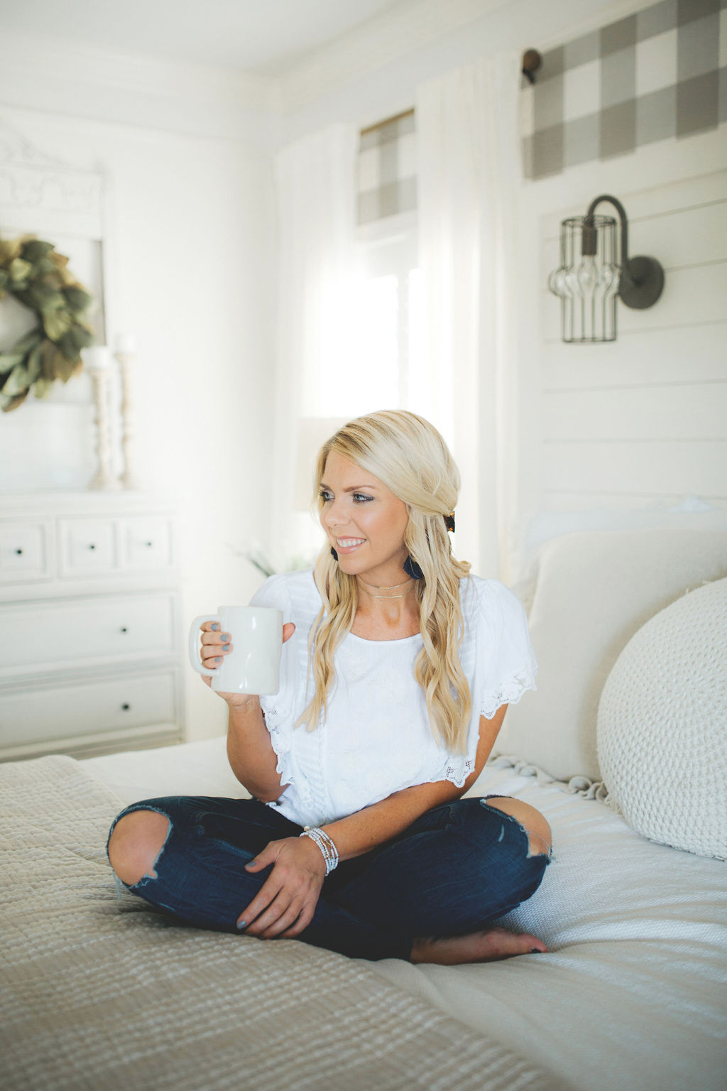 carissa with coffee cup on bed