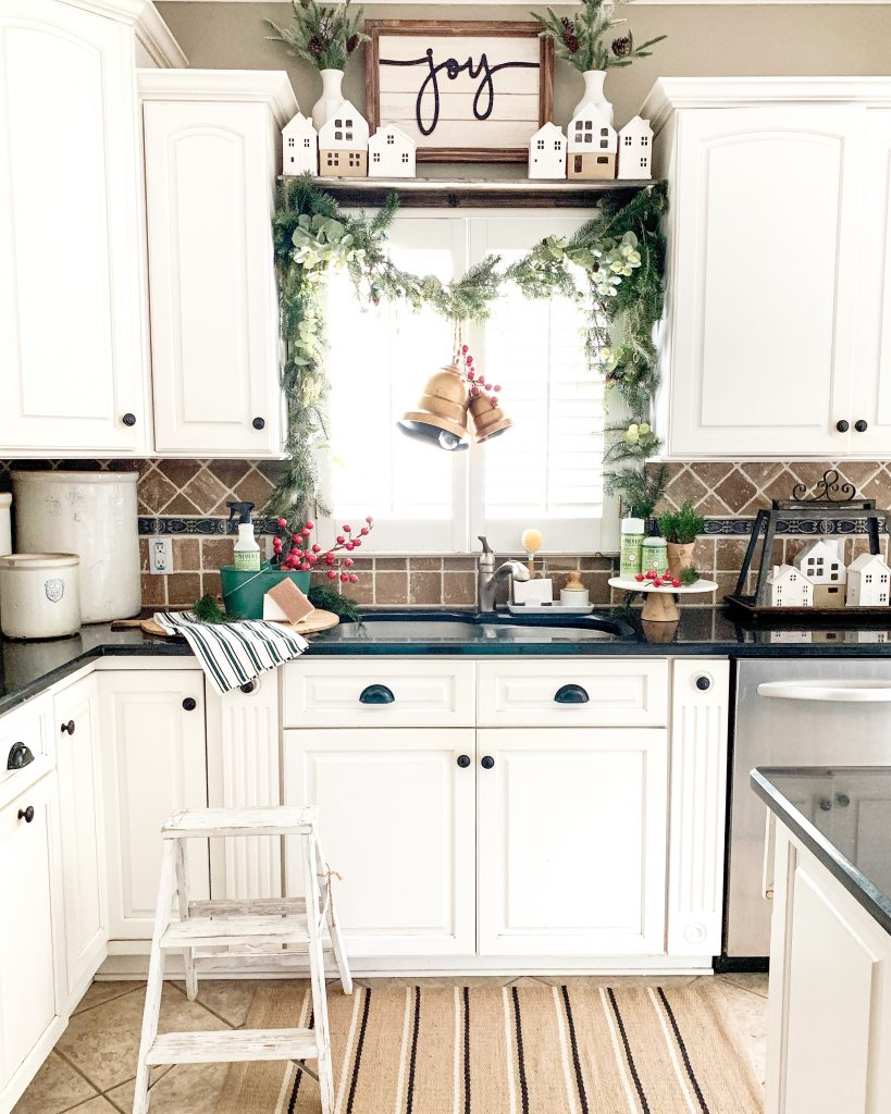 Kitchen window above sink with garland decor.