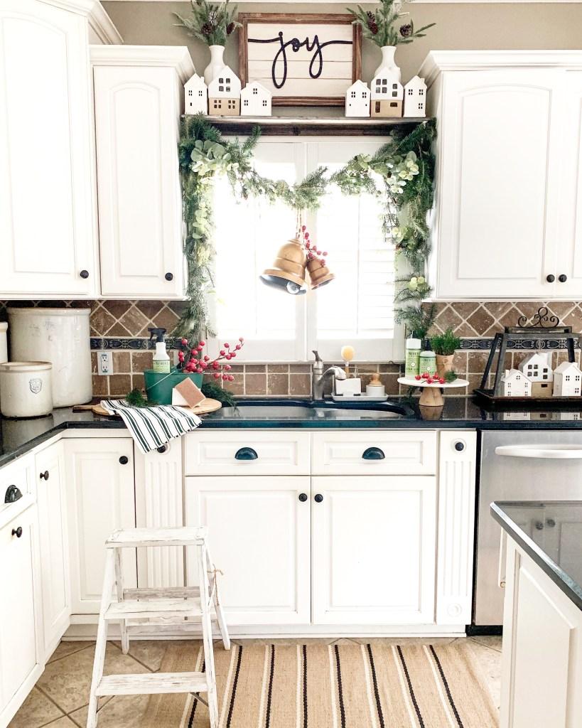 Kitchen window above sink with garland decor.