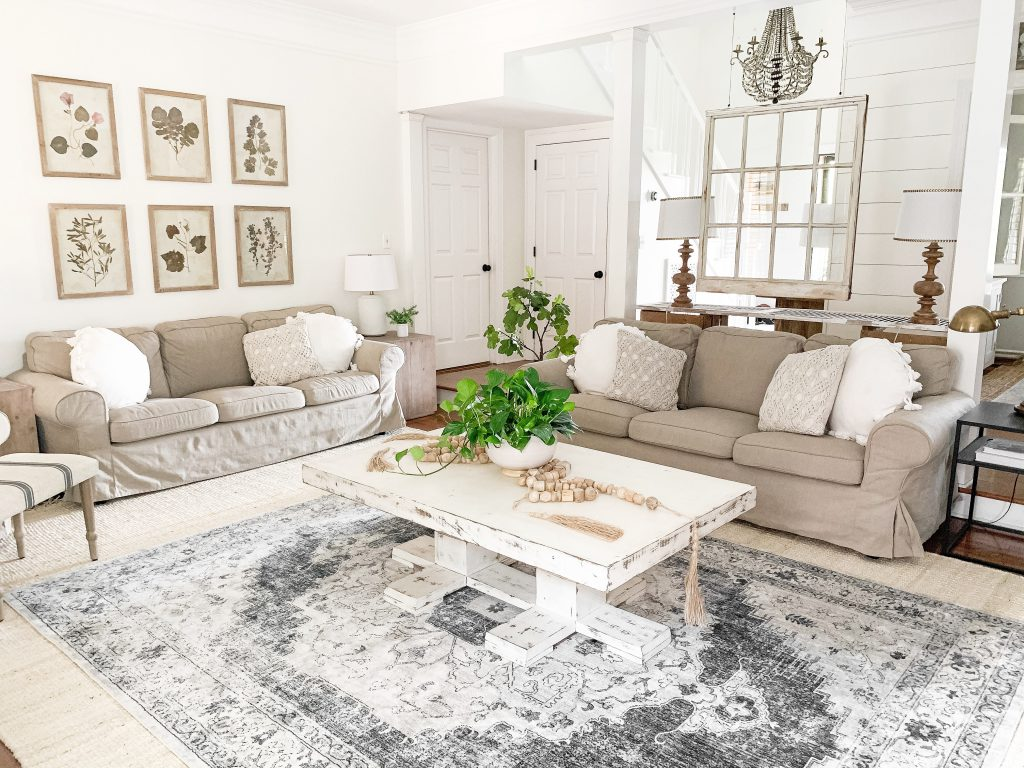 view of neutral living room sofas and coffee table