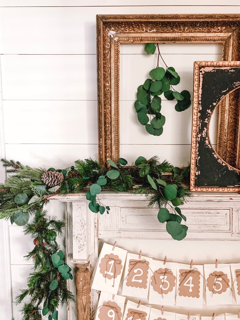 Gold picture frame on mantel.