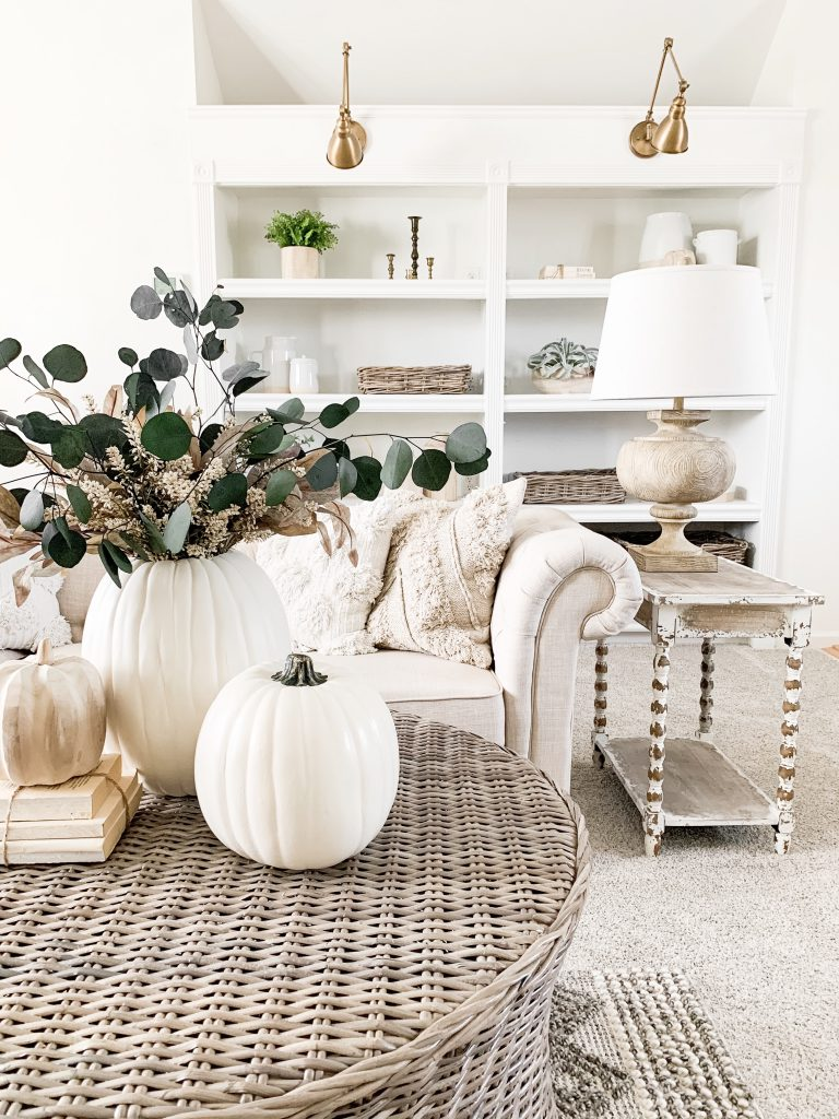 3 white pumpkins on coffee table