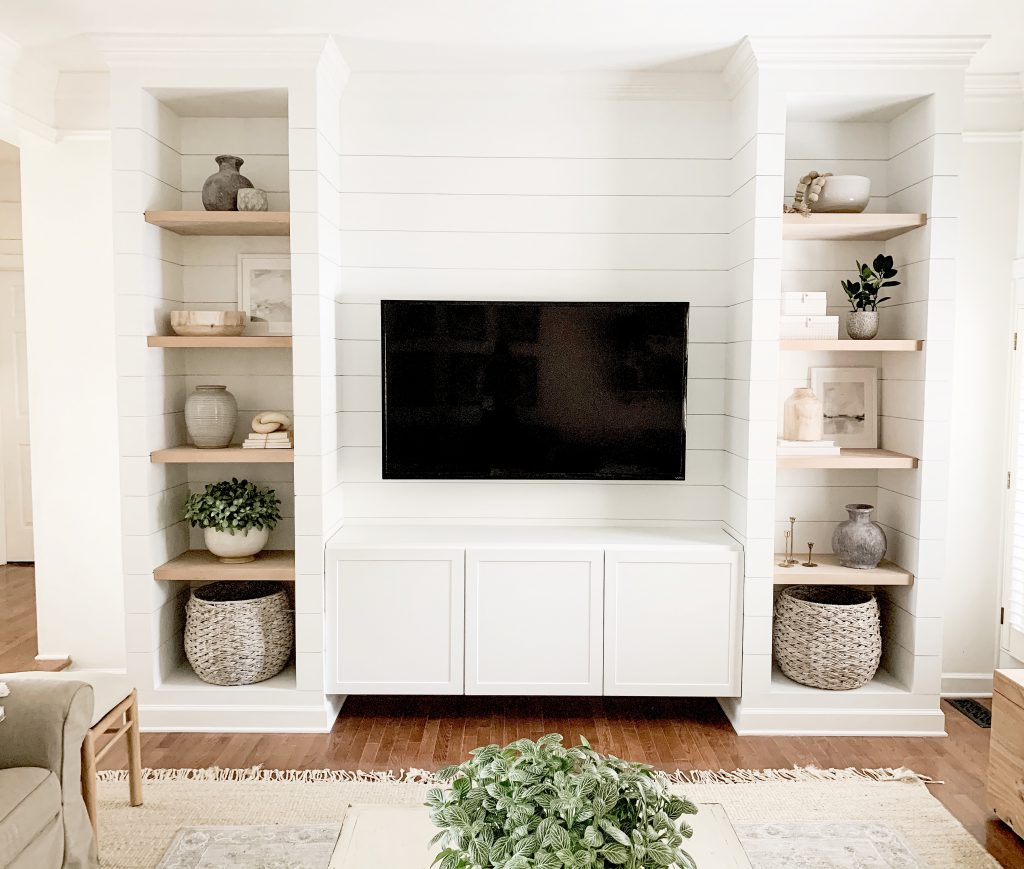 view of full living room wall with media cabinet