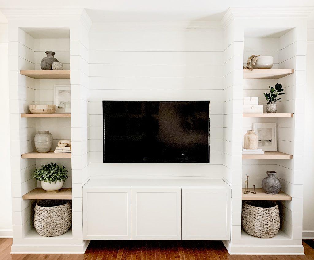 media built in reveal with decor on shelves