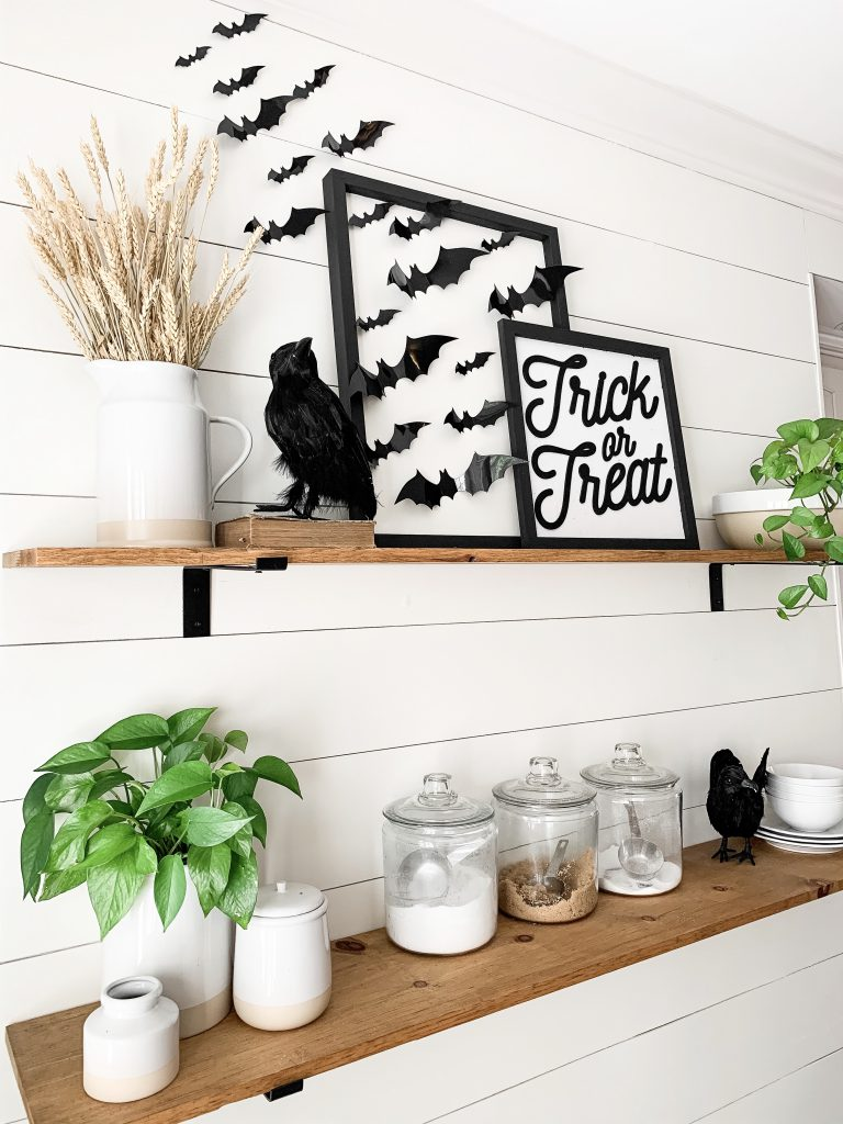 side view of Halloween signs and crow decor