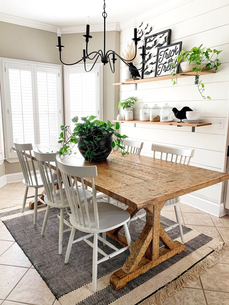 kitchen table in eating area with plant centerpiece