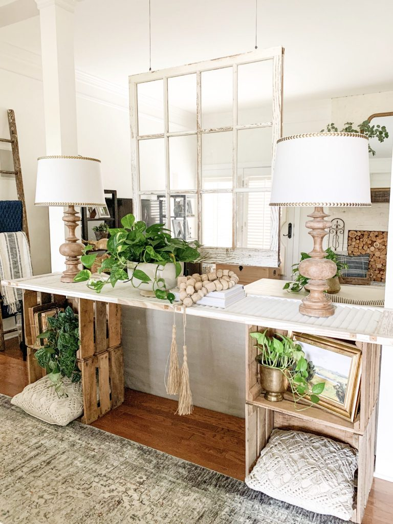 console table with window hanging above