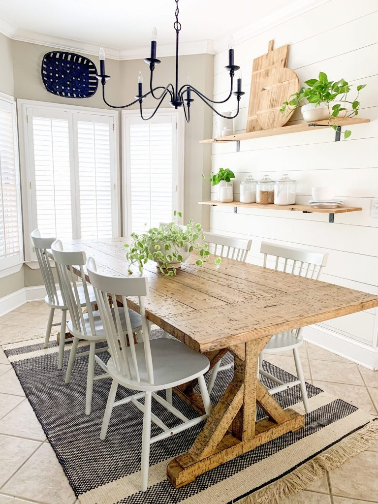 farmhouse table with houseplant as centerpiece