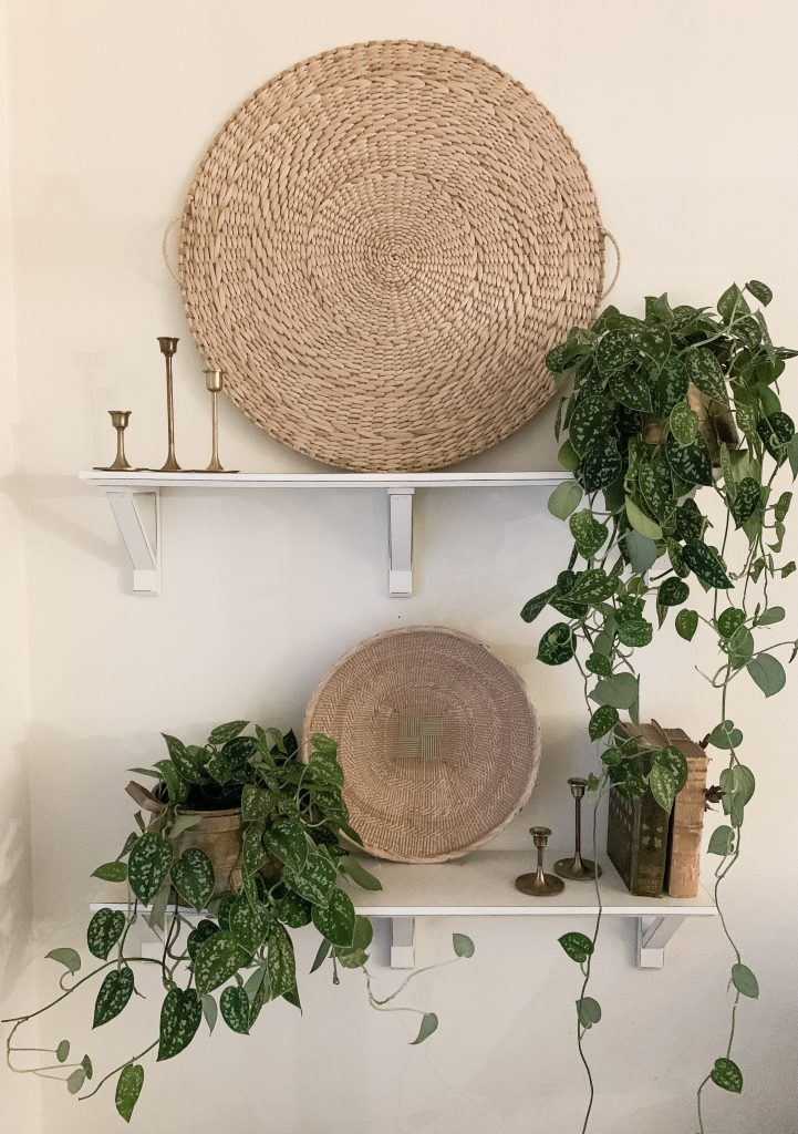 large basket and small basket on white shelves