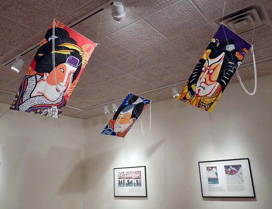 Kites hanging at the exhibit.