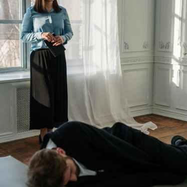 woman in blue long sleeve shirt sitting on floor