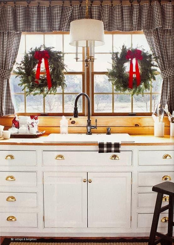 wreaths in farmhouse kitchen windows