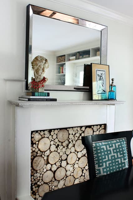 Add a rustic touch to your decor with a stacked log fireplace