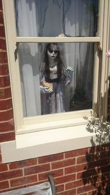 22-scary-child-standing-by-the-window-is-a-cool-and-frightening-idea