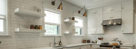 white kitchen with natural light from open roller shades and butcher block island
