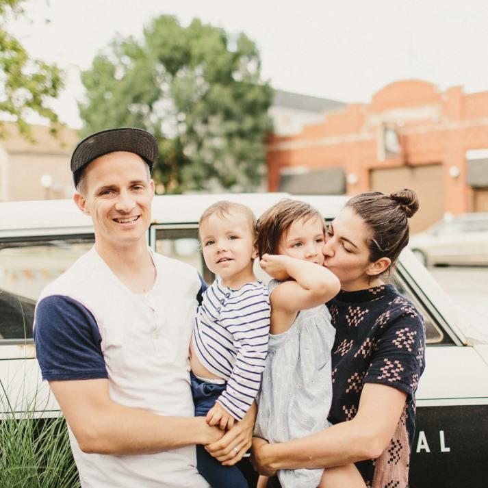 Amanda Jane Jones family photo holding children in front of car