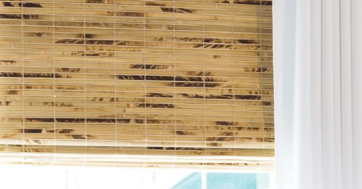 Close-up image of Blinds.com woven wood shades in the color Antigua Natural