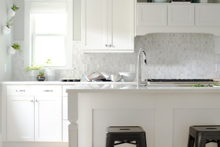 white kitchen with small marble tile backsplash and white roman shades - Kitchen Window Ideas
