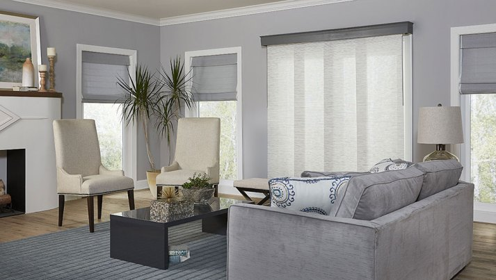 neutral grey living room with fabric panel blind covering sliding glass door