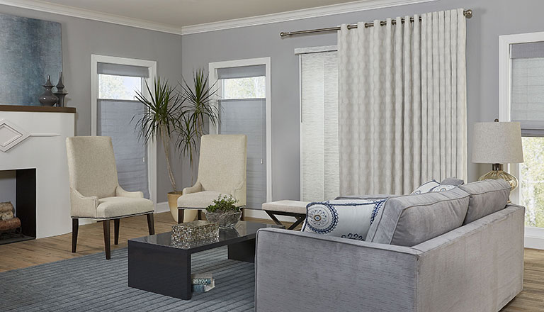 Contemporary Living Room With Grey Walls, Top Down Woven Wood Shades And  Sliding Glass Door