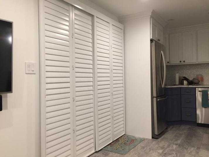 kitchen with sliding plantation shutters for sliding glass door to patio