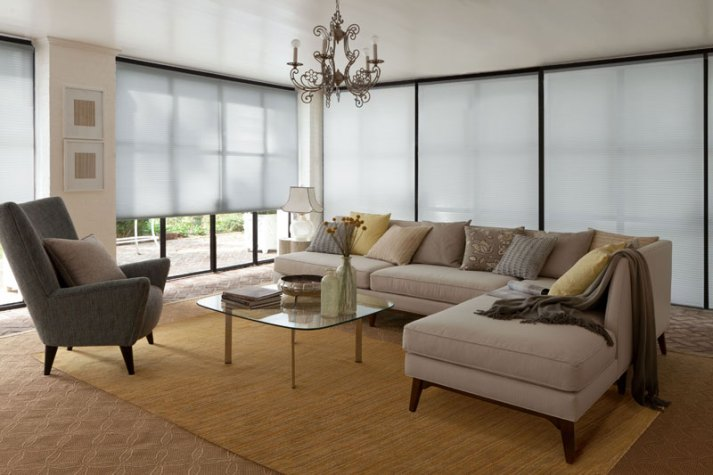 cellular shades cover large windows in living room