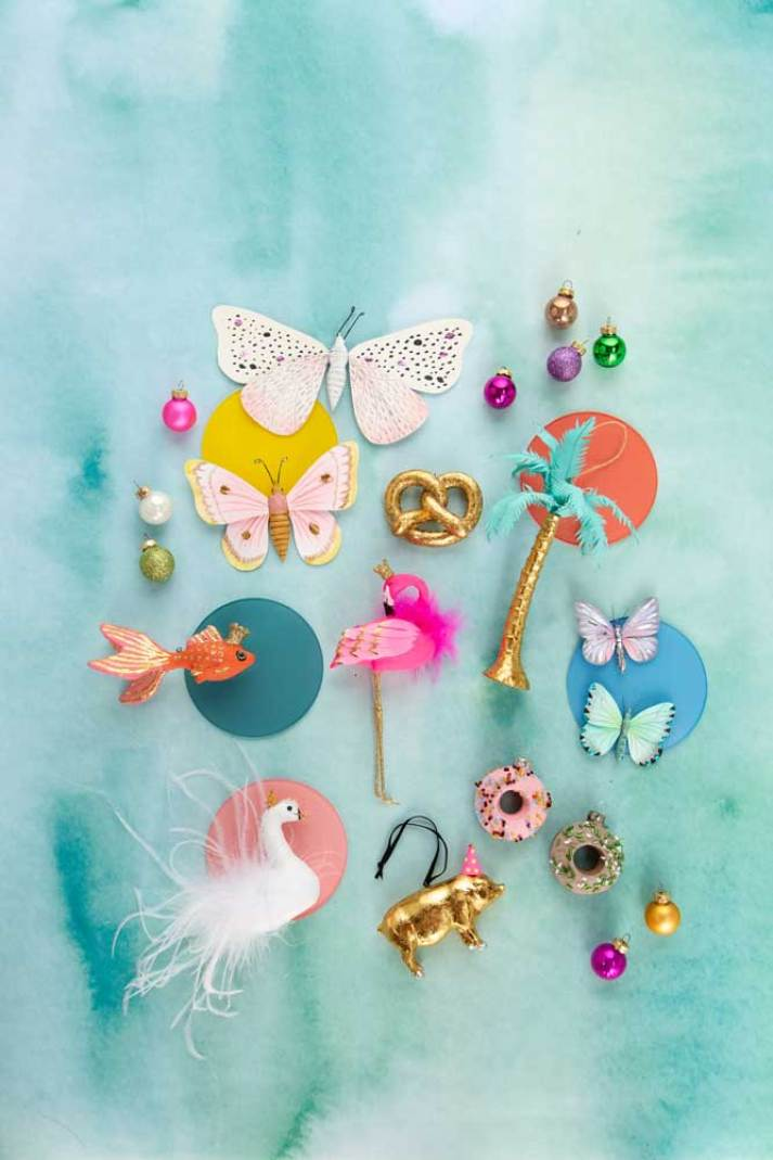non traditional animal christmas ornaments including butterflies, flamingo, swan, goldfish and donuts